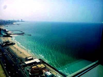 2 Bedroom Apartment for Rent in Corniche Ajman, Ajman - CORNICHE TOWER: FULL SEA VIEW CHILLER FREE 2 BEDROOMS HALL