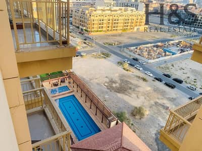 Studio for Sale in Jumeirah Village Circle (JVC), Dubai - Pool View I Vacant  Studio W/ Balcony I The Manhattan