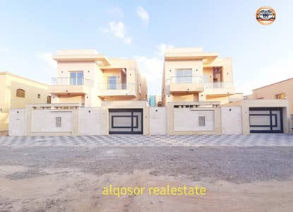 5 Bedroom Villa for Sale in Al Mowaihat, Ajman - Villa for sale in Ajman, Al Mowaihat area, modern design with excellent stone face, finishes with the possibility of bank financing