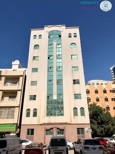 شقة 1 غرفة نوم للايجار في منطقة الرولة، الشارقة - 13 MONTHS CONTRACT 1 B/R HALL FLAT IN UM ALTARAFA AREA BEHIND SHJ CENTRAL POST OFFICE