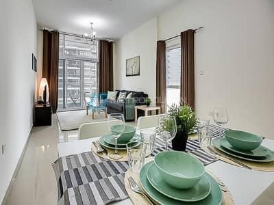 فلیٹ 2 غرفة نوم للبيع في مدينة دبي الرياضية، دبي - Fully Furnished I Spacious and Bright 2BR Mid flr