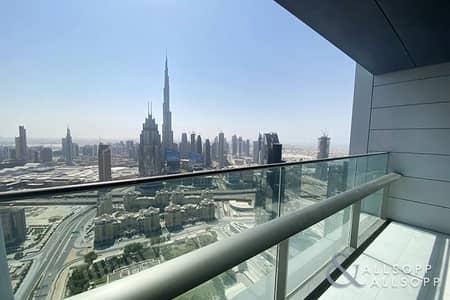 فلیٹ 2 غرفة نوم للايجار في مركز دبي المالي العالمي، دبي - Balcony | Corner Unit | Burj View | 2 Beds