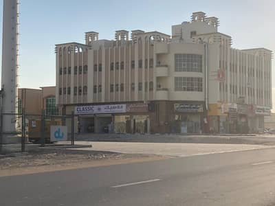 Building for Sale in Al Rawda, Ajman - Building for sale, ground floor, two, and roof   9% income in Rawda, Qar Street