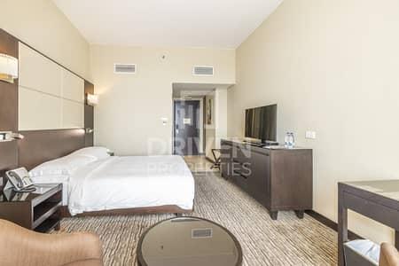 شقة فندقية  للبيع في أبراج بحيرات الجميرا، دبي - Prime Location and Furnished Studio Apt