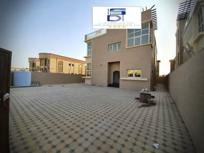 5 Bedroom Villa for Sale in Al Rawda, Ajman - Stone villa For a shot Featured site Without down payment For premiums starting from 5,500 dirhams