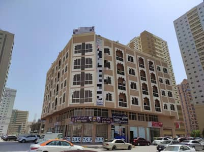 Building for Sale in Al Nuaimiya, Ajman - Front Building Picture