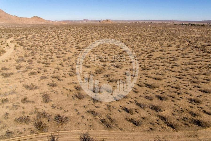 2 Massive land! Main road of Khalifa City C