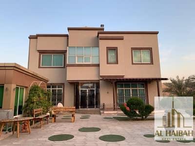 6 Bedroom Villa for Sale in Al Gharayen, Sharjah - For sale a two-story villa in Sharjah