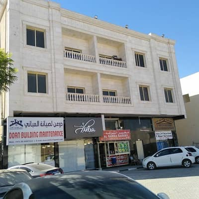 Building for Sale in Al Rawda, Ajman - Building for sale in Rawda, current income of 500 thousand, age 2 years