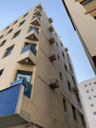 مبنى سكني  للبيع في النباعة، الشارقة - Building For sale in Al Nabaa  Sharjah