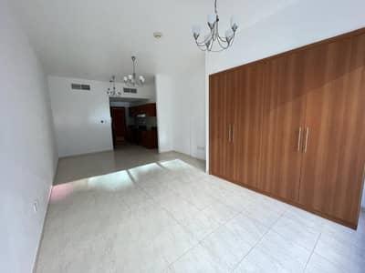 Studio for Rent in Dubailand, Dubai - Full Al Ain Road View | Standard  Size Studio Apt. | Mid Floor
