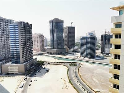 2 Bedroom Apartment for Rent in Dubai Sports City, Dubai - Fully Furnished 2 Bedroom Apartment for Rent in The Bridge Dubai Sports City with Full Canal & Stadium View