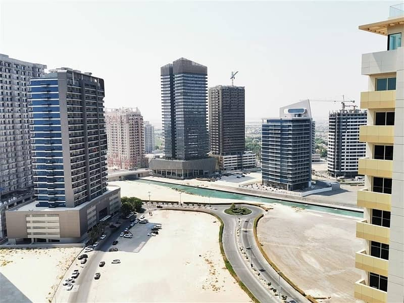 Fully Furnished 2 Bedroom Apartment for Rent in The Bridge Dubai Sports City with Full Canal & Stadium View