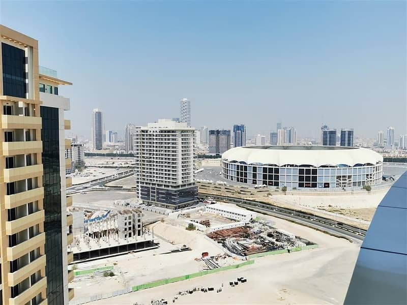 16 Fully Furnished 2 Bedroom Apartment for Rent in The Bridge Dubai Sports City with Full Canal & Stadium View