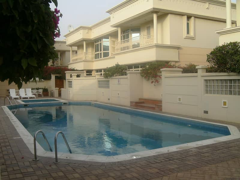 Compound 4bhk villa with p .garden s.pool in safa 2 rent is 180k