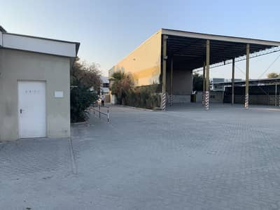 Industrial Land for Sale in Al Quoz, Dubai - Al Quoz total plot area 51000SqFt. open shed furbished offices 500KW electricity