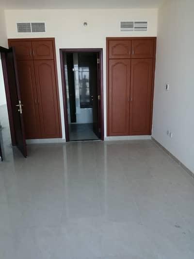 2 Bedroom Flat for Sale in Corniche Ajman, Ajman - Master BedroomWardrobes