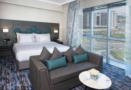 Hotel Apartment for Rent in Deira, Dubai - No Commission -Modern Deluxe Room at Edge Creekside Hotel Save