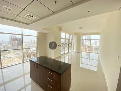 فلیٹ 1 غرفة نوم للايجار في قرية جميرا الدائرية، دبي - Live In Full Glass Building| High Floor 2BHK