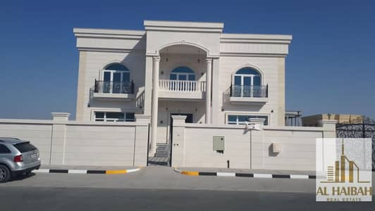 فیلا 5 غرف نوم للبيع في حوشي، الشارقة - For sale a new two-storey villa with a very luxurious stone facade