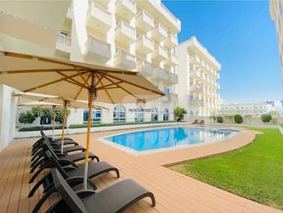 2 Bedroom Flat for Rent in Jumeirah Village Circle (JVC), Dubai - COMPLETELY FURNISHED | CHILLER FREE | BALCONY