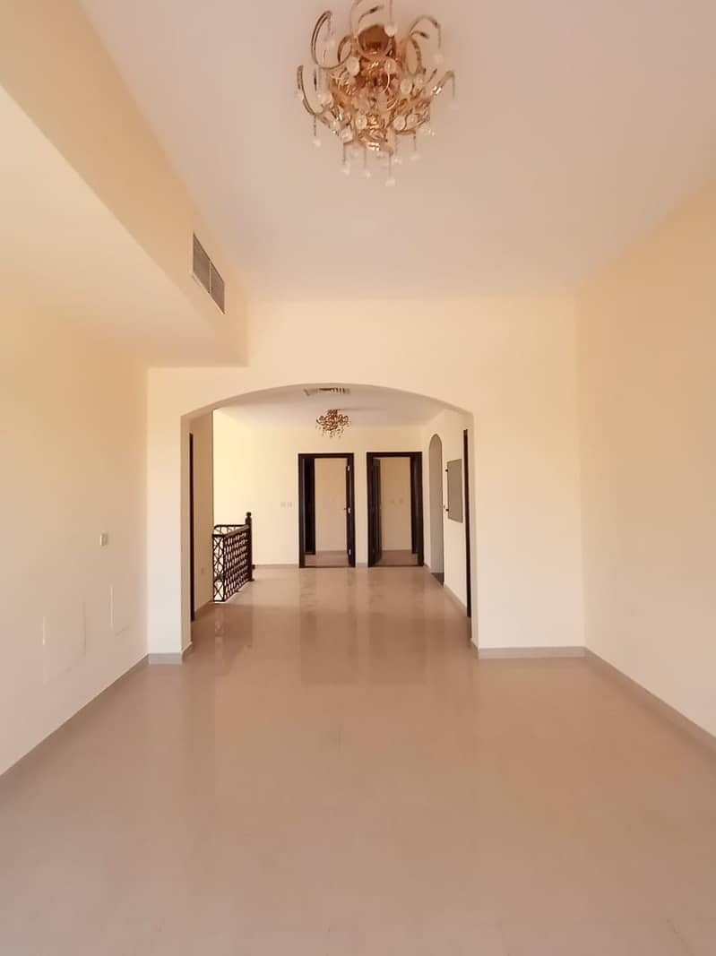Super Lux villa for rent in Al Warqaa (4 master bedrooms + large hall + large majlis + raw room + large kitchen + laundry room + dining room + laundry room + large planted garden + covered parking)