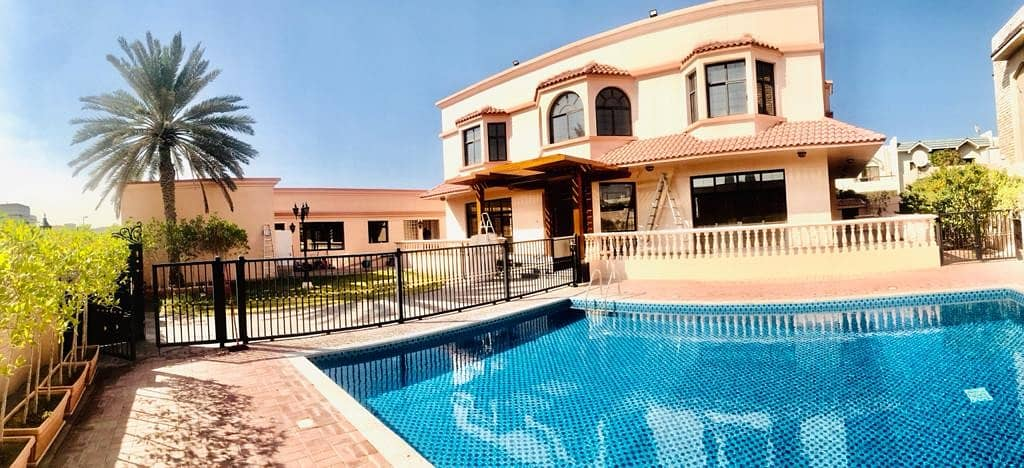 Spacious 5 bedroom plus maid independent villa with private pool and private garden in Jumeirah 2