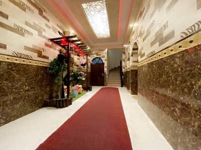 شقة 1 غرفة نوم للايجار في الكرامة، أبوظبي - شقة في الكرامة 1 غرف 65000 درهم - 4928580