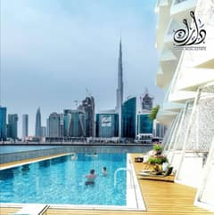 Apartment for sale overlooking Burj Khalifa | And at a discount of 25% from its price