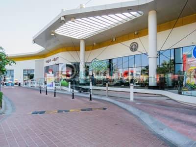 محل تجاري  للايجار في موتور سيتي، دبي - Available Shop I Ribbon Mall I Motor City