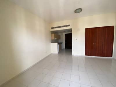 Studio for Rent in International City, Dubai - cheapest Studio apartment with hanging Balcony for rent in 16000